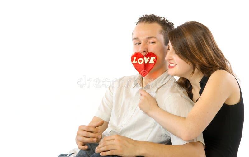 夫妇愉快的棒棒糖 库存图片