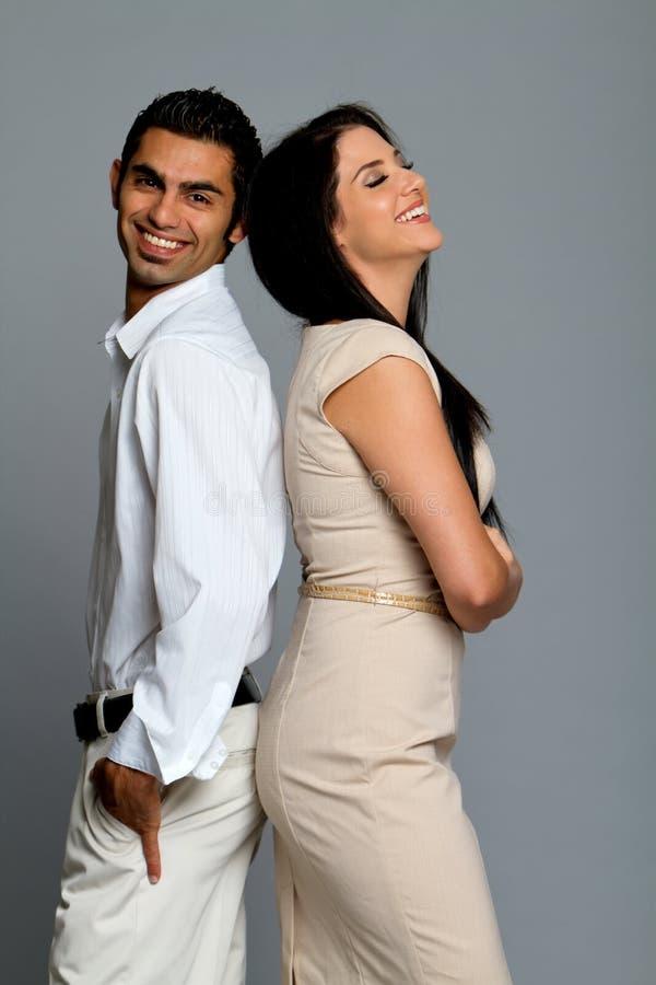 夫妇愉快的笑的年轻人 库存照片