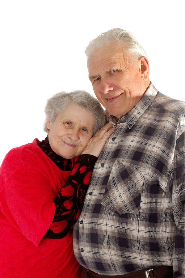 夫妇愉快的老微笑 图库摄影