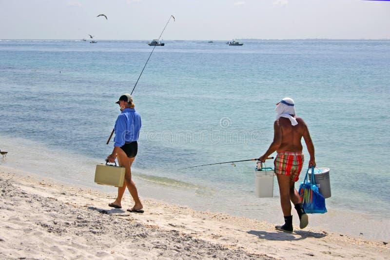 夫妇捕鱼海运 免版税库存图片