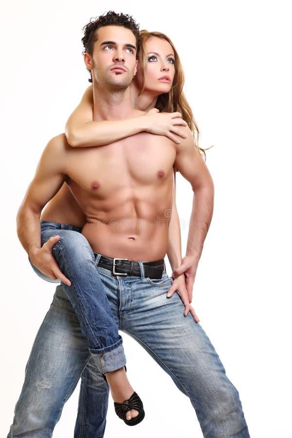夫妇生动描述露胸部 库存图片