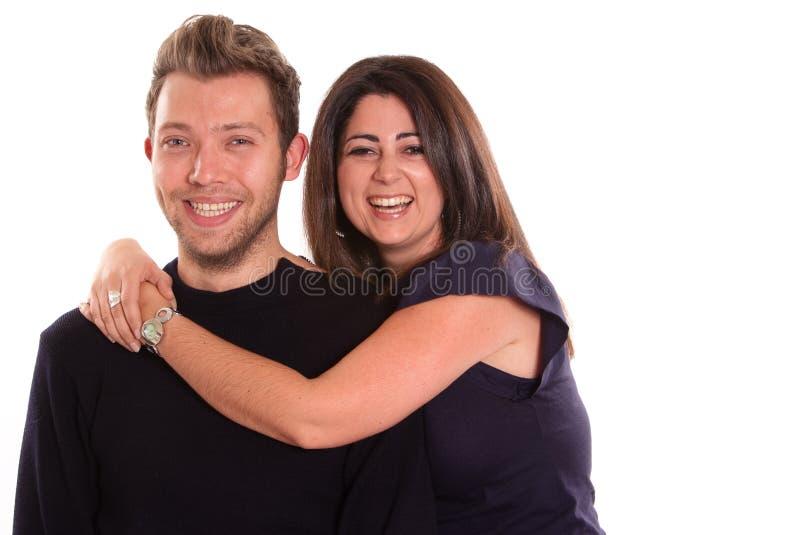夫妇笑的年轻人 免版税库存图片
