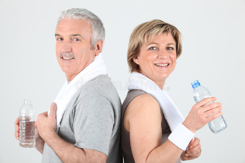 夫妇纵向高级运动 免版税图库摄影