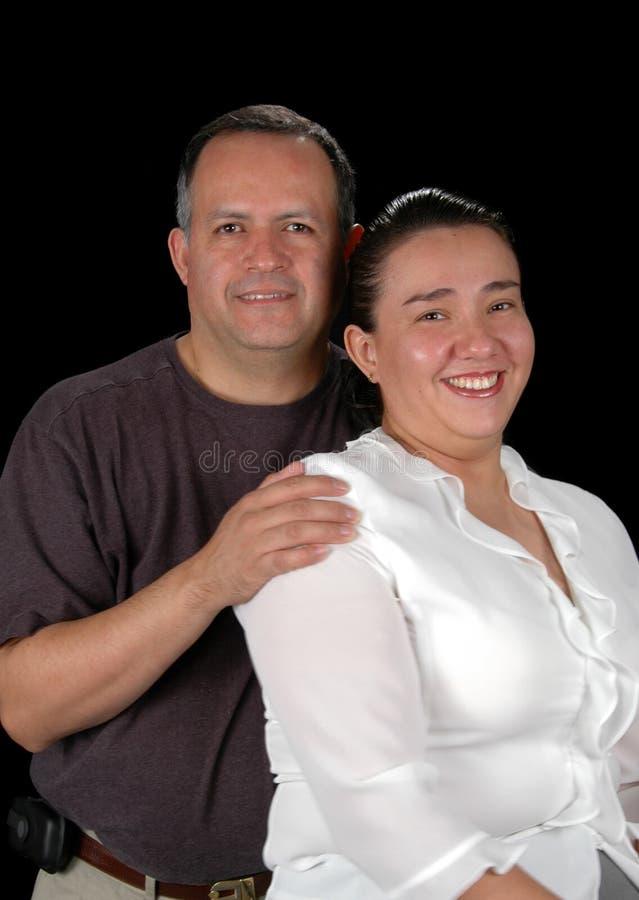 夫妇讲西班牙语的美国人 库存图片