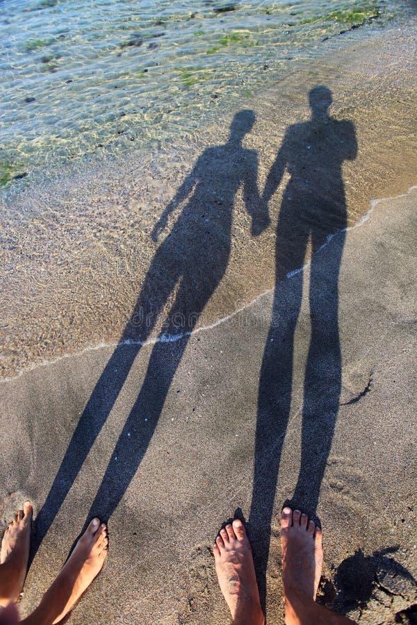 夫妇递藏品长的影子 库存照片