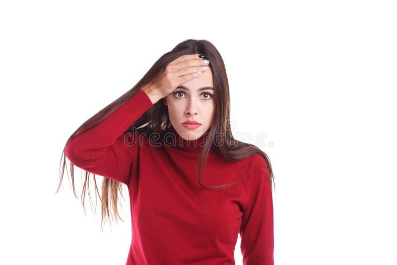 失望的女孩,对前额的举行手由于一个困窘的情况 查出在白色 免版税图库摄影