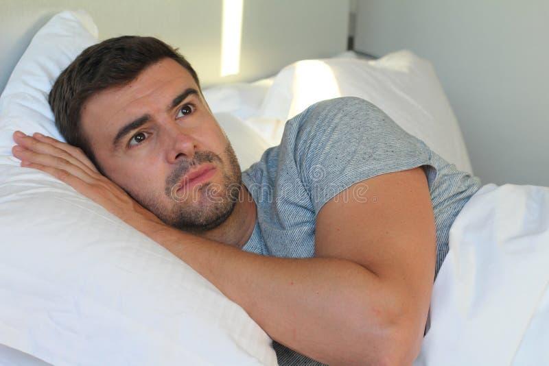 失眠的英俊的人感觉哀痛 免版税图库摄影