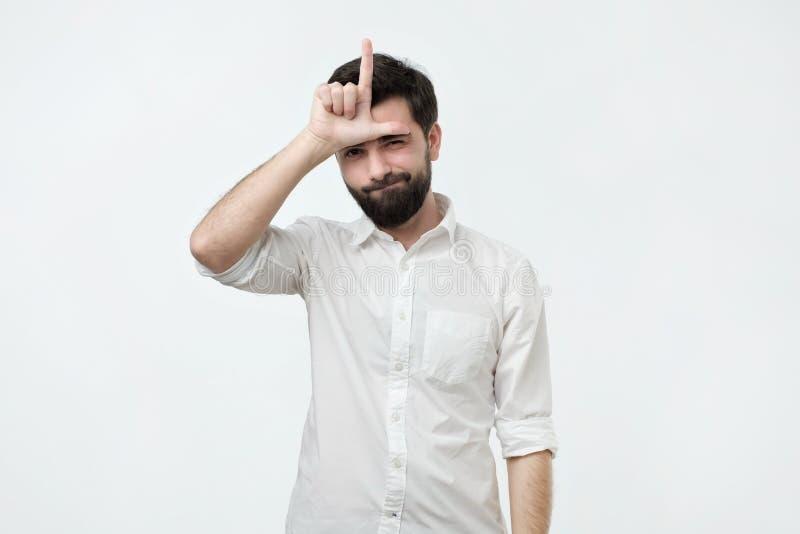失败者回家 有黑胡子的西班牙人自夸关于胜利的 免版税库存图片