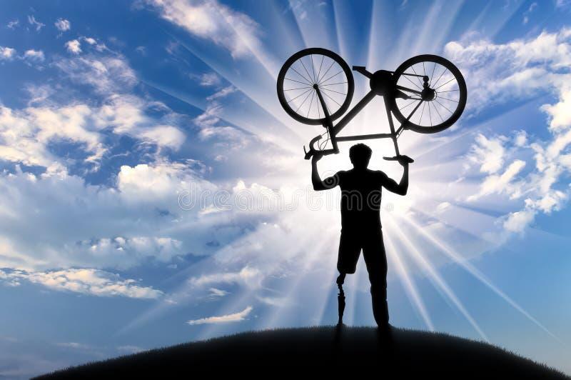 失去能力与假肢保留自行车日落 库存照片