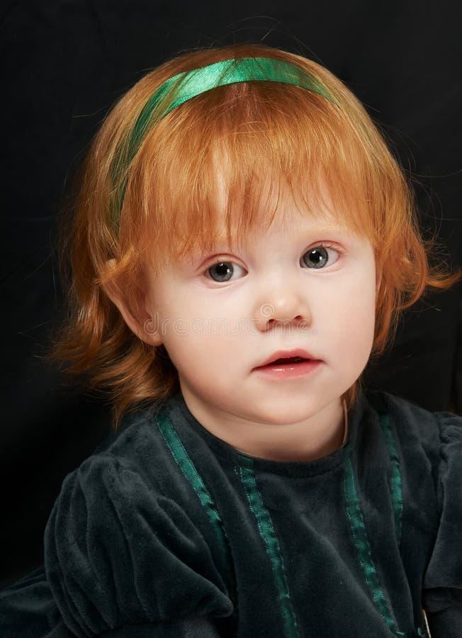 头发的女婴红色的矮小 免版税库存图片
