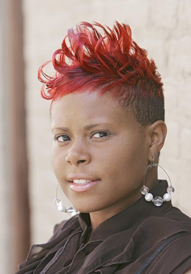 头发的红色妇女 免版税库存图片