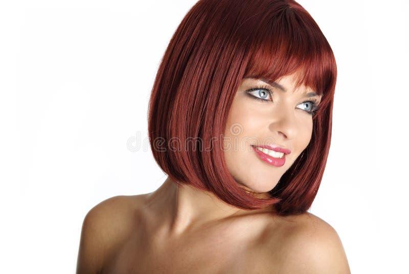 头发纵向红色性感的妇女 库存图片
