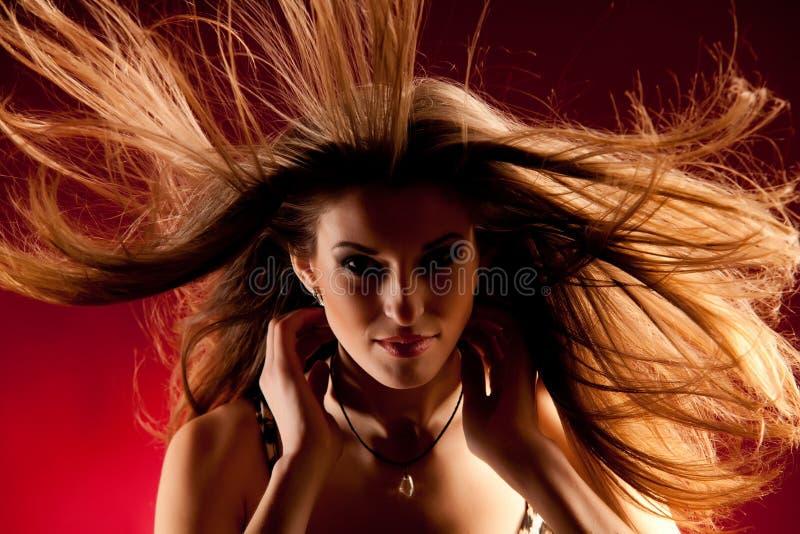 头发长的风 免版税库存照片
