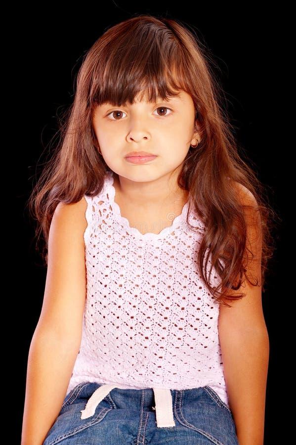 头发黑暗的女孩安静地一点 免版税图库摄影