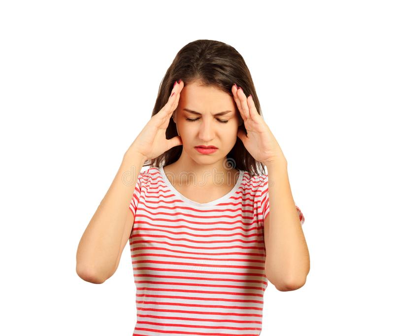 头疼和重点 感觉强的顶头痛苦的美丽的少妇 在白色背景隔绝的情感女孩 免版税库存照片