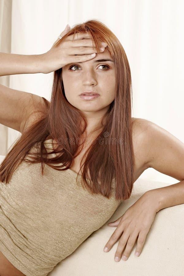头疼妇女 库存图片