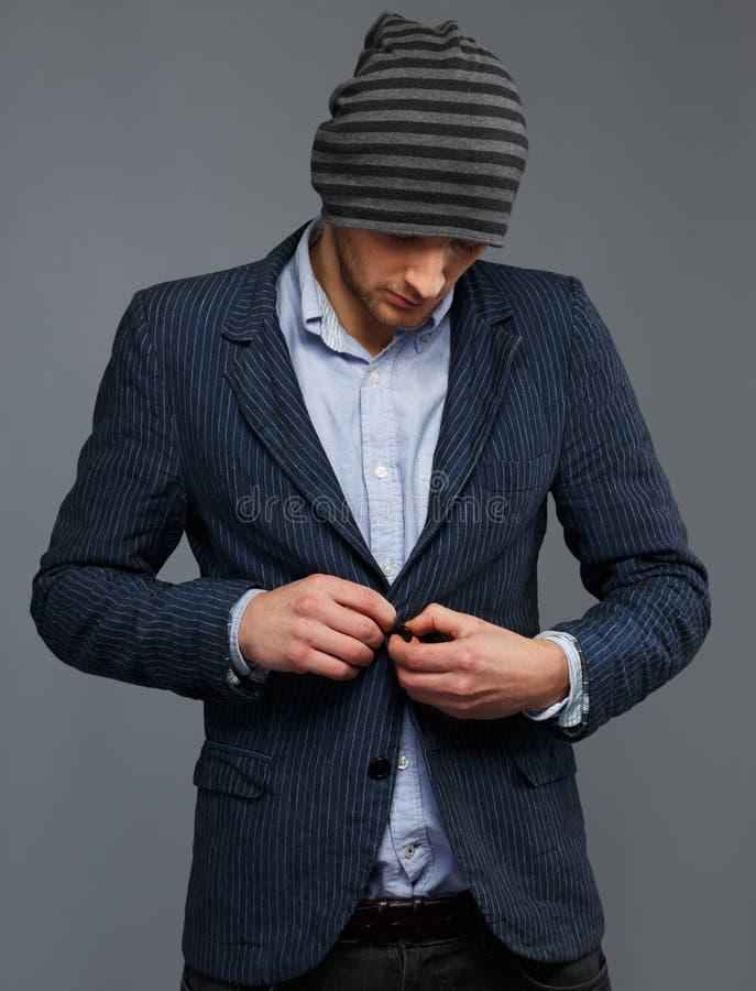 夹克和帽子的人 库存照片
