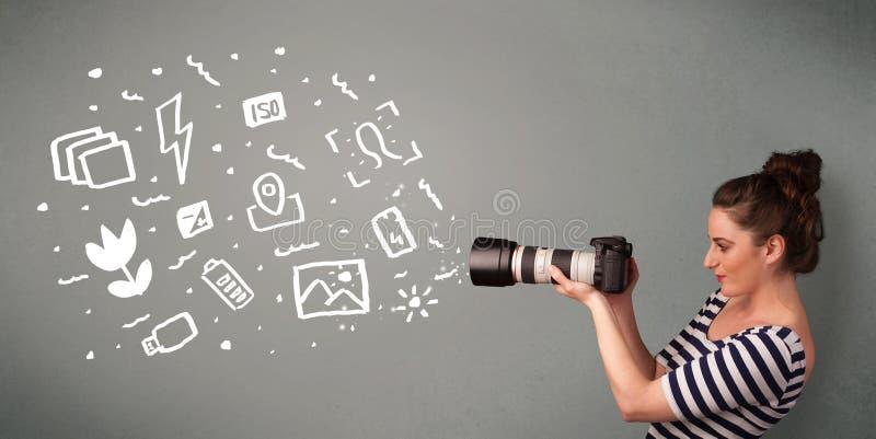 夺取白色摄影象和标志的摄影师女孩 库存图片