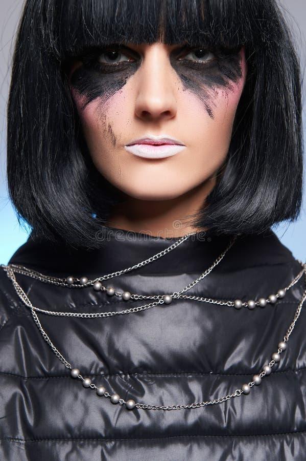 奇怪的构成,有黑发的低劣的女孩 免版税库存照片