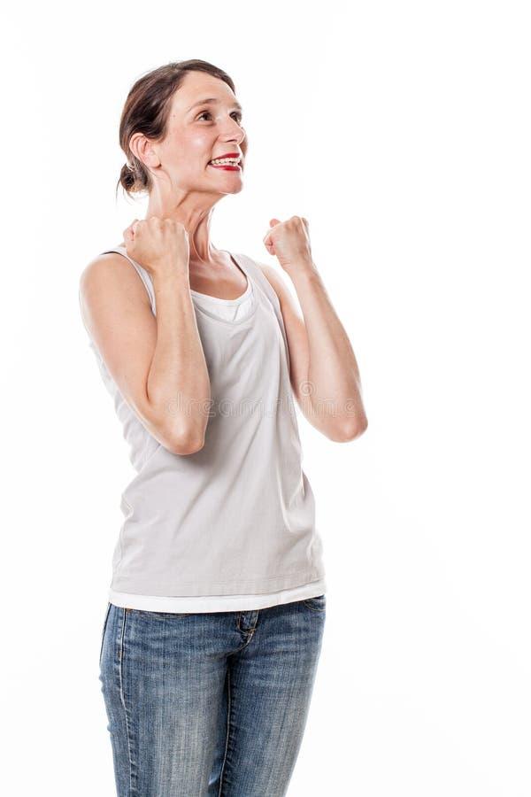 兴奋的少妇打手势,站立为乐趣胜利 库存照片