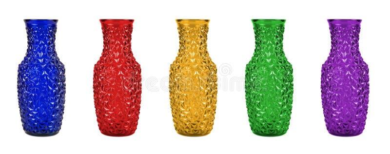 套五颜六色的玻璃花瓶 免版税库存照片