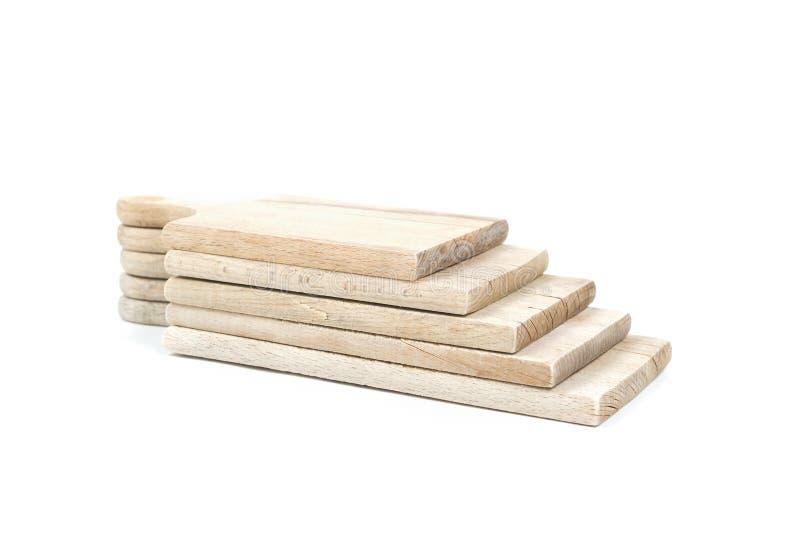套在彼此的使用的棕色木切板堆在白色背景隔绝了 免版税库存照片
