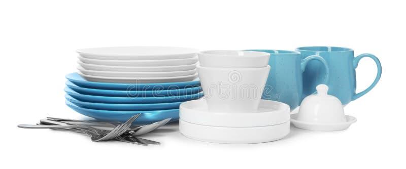套在白色背景的干净的碗筷 库存照片