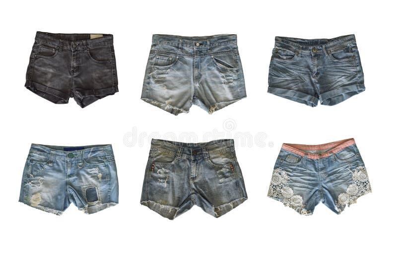 套在白色背景隔绝的女性的牛仔布短裤 库存图片
