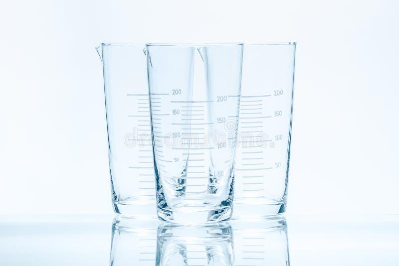 套测量的三个空的温度抗性圆锥形烧杯 免版税库存照片