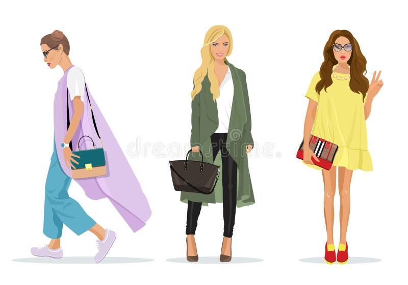 套美丽的年轻时髦的妇女以时尚穿衣与辅助部件 皇族释放例证