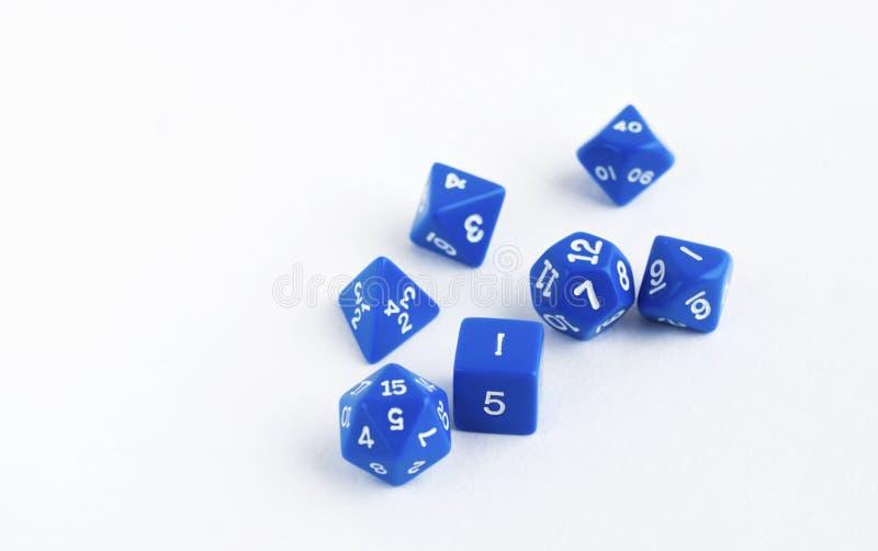 套蓝色为rpg切成小方块, dnd或棋在白色背景 图库摄影