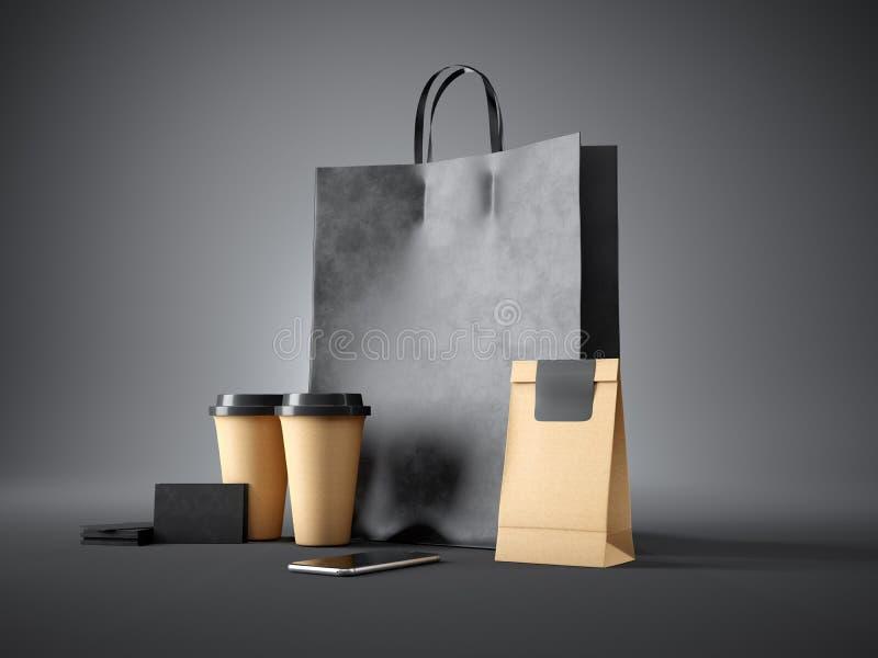 套黑购物袋、咖啡杯、纸包裹、空白的名片和普通设计智能手机 黑暗 库存图片