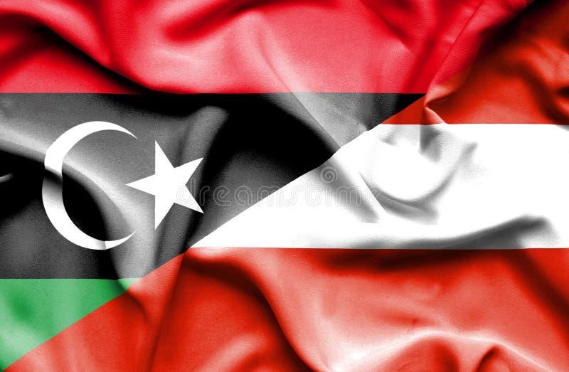奥地利和利比亚的挥动的旗子 皇族释放例证