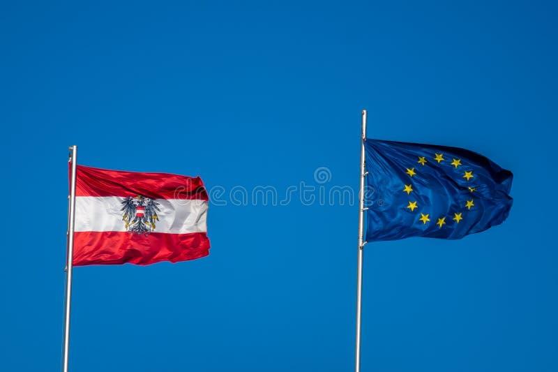 奥地利和欧盟旗子欧盟委员会总统的职务的 免版税库存照片