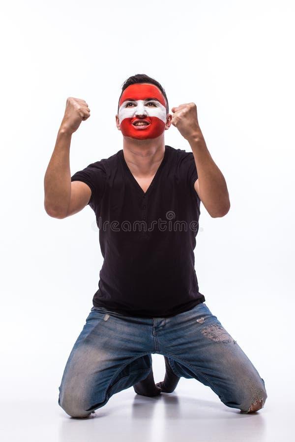 奥地利足球迷的胜利,愉快和目标尖叫情感在奥地利的比赛支持的 库存照片