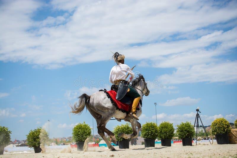 奥托曼在他的马的御马者骑马 库存照片