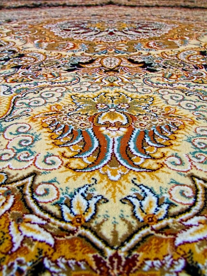 奥斯陆王宫波斯地毯样式,有一个复杂设计的波斯地毯 免版税库存图片