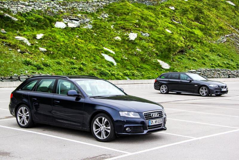 奥迪A4 Avant和BMW F11 5系列游览 免版税库存图片