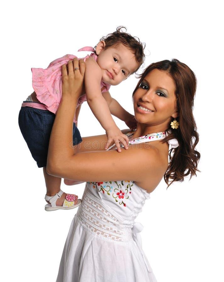 女儿讲西班牙语的美国人母亲 免版税图库摄影