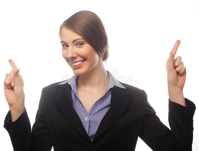 女商人展示在白色隔绝的某事 免版税库存图片