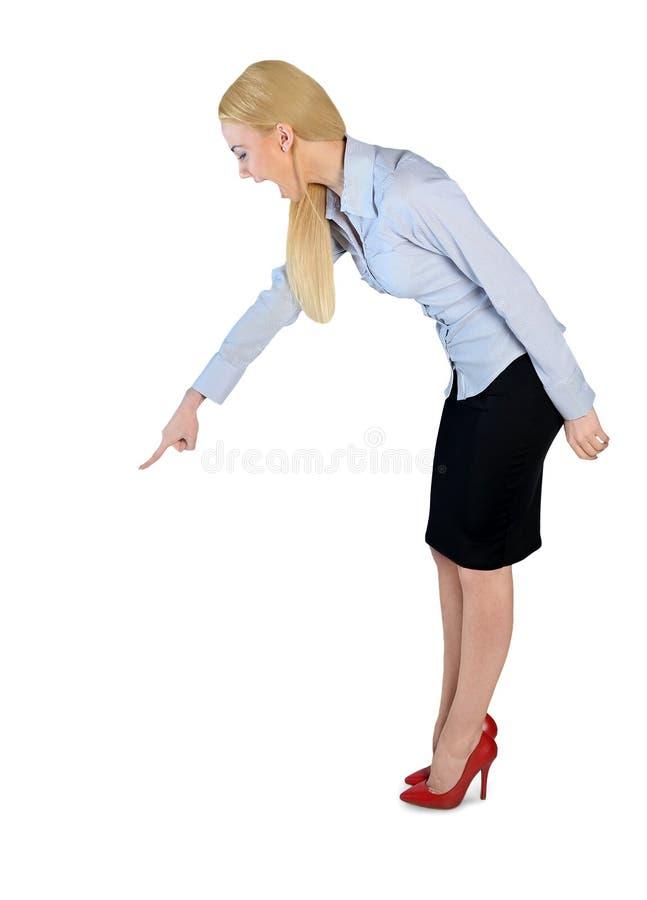 女商人恼怒指向下来 免版税库存图片