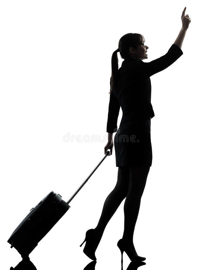 女商人旅行的走称赞的剪影 免版税库存照片
