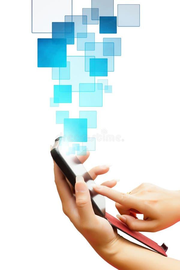 女商人的手推挤在巧妙的电话的一个触摸屏接口的隔绝了白色背景 免版税图库摄影