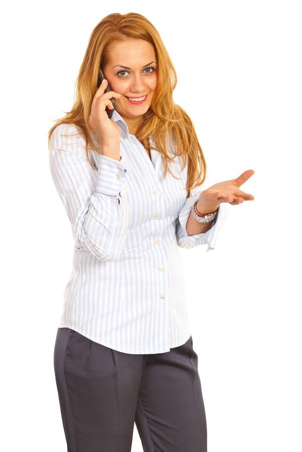 女商人联系由移动电话 库存照片