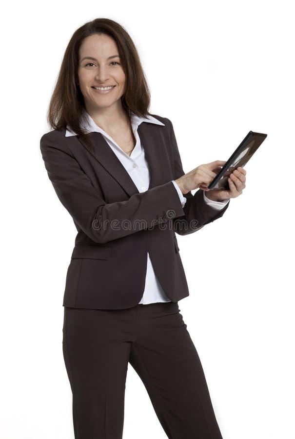 女商人藏品片剂设备 免版税图库摄影