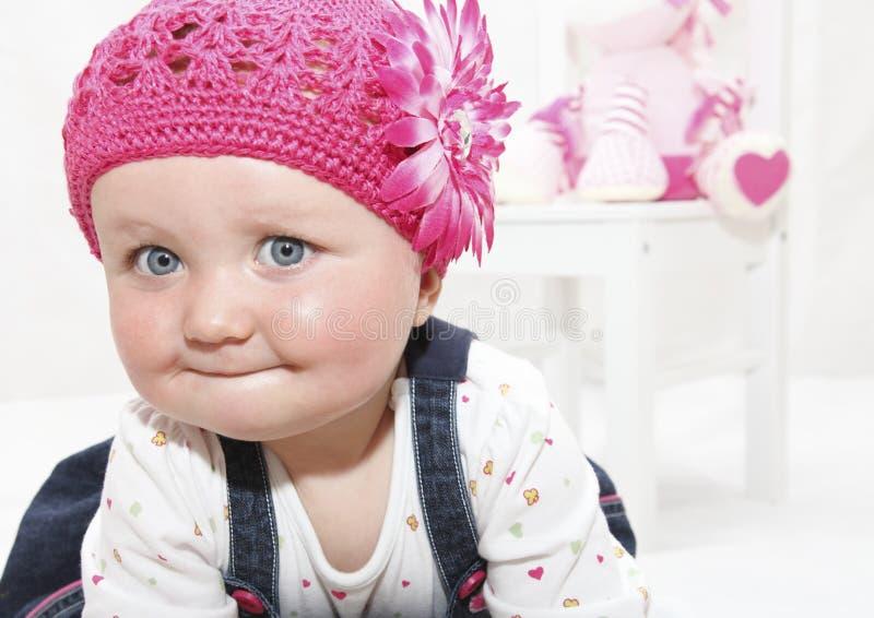 女婴愉快的帽子粉红色 库存图片