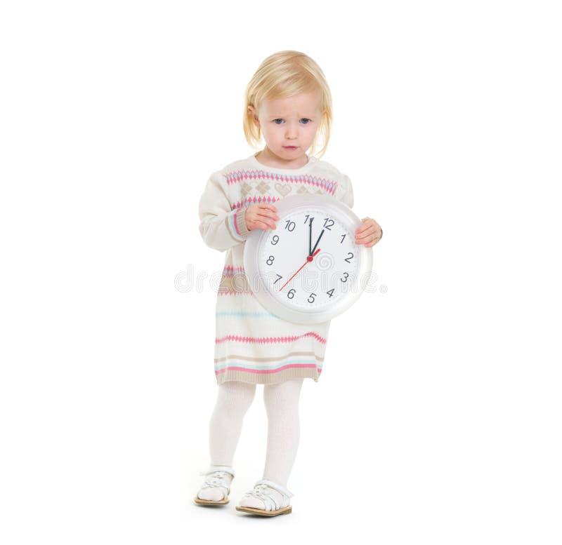 女婴藏品时钟圣诞节纵向  免版税库存照片