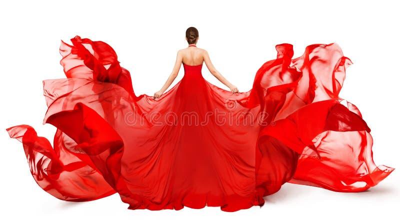女子后视红色飞裙风中飘扬 免版税库存照片