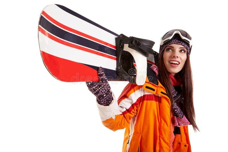 女子微笑的滑雪者女孩佩带的毛皮背心滑雪使用Google 免版税库存照片