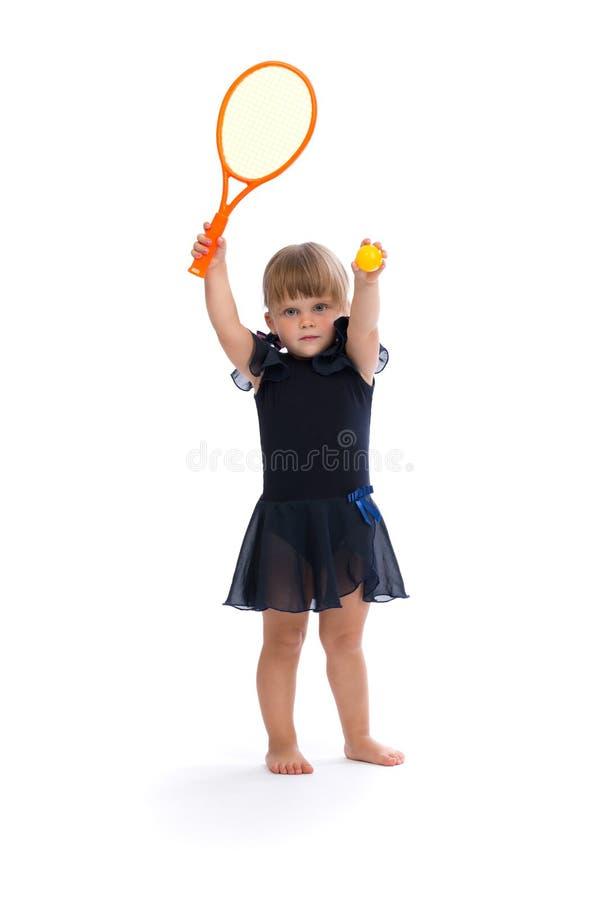女孩一点使用的网球 免版税库存图片